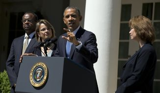 President Obama speaks June 4, 2013, in the Rose Garden of the White House while announcing the nominations of (from left) Robert Wilkins, Cornelia Pillard and Patricia Ann Millet to the D.C. Circuit Court of Appeals. (Associated Press)