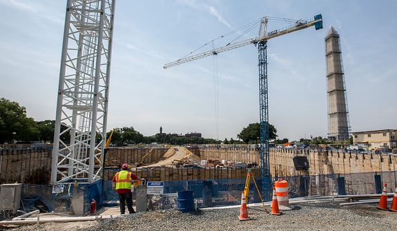 Cranes soar above a worksite as construction continues on The Smithsonian Institution's National Museum of African American History and Culture which will open in 2015, in Washington, DC Tuesday, May 28, 2013.  (Andrew S Geraci/The Washington Times)