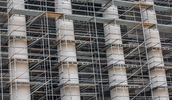 Scaffolding encompasses the entire building as renovation efforts are put in place at the National Gallery of Art, in Washington, DC Tuesday, May 28, 2013.  (Andrew S Geraci/The Washington Times)
