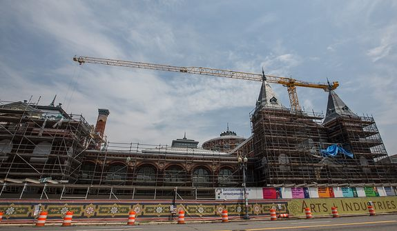 Scaffolding encompasses the entire building as renovation efforts are put in place at the Smithsonian's Art & Industrial Building, in Washington, DC Tuesday, May 28, 2013.  (Andrew S Geraci/The Washington Times)