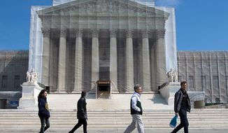 ** FILE ** Visitors walk past the Supreme Court in Washington on Saturday, March 23, 2013. (AP Photo/Jacquelyn Martin)