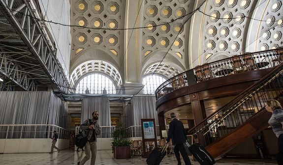 Construction beams and netting line the ceiling as visitors and patrons of Union Station travel to their destinations, in Washington, DC Tuesday, May 28, 2013.  (Andrew S Geraci/The Washington Times)