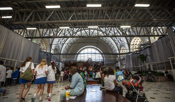 Construction beams and netting line the ceiling as visitors and patrons of Union Station travel to their destinations, in Washington, DC Wednesday, May 29, 2013.  (Andrew S Geraci/The Washington Times)