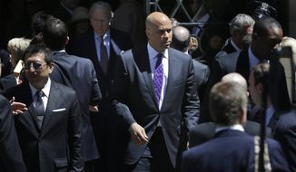 Newark Mayor Cory Booker (center) leaves the Park Avenue Synagogue after a funeral service for Sen. Frank R. Lautenberg in New York on Wednesday. Mr. Lautenberg died Monday. Special primary and general elections will be held this year to choose a replacement. The vacancy presents an opportunity for many in the state. (Associated Press)