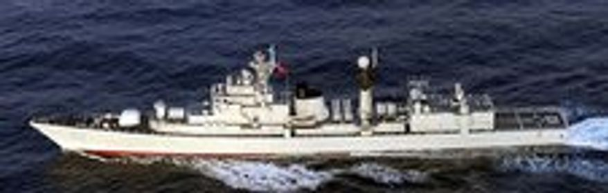 Japan's Defense Ministry has released photos showing three Chinese warships close to Okinawa on May 27.