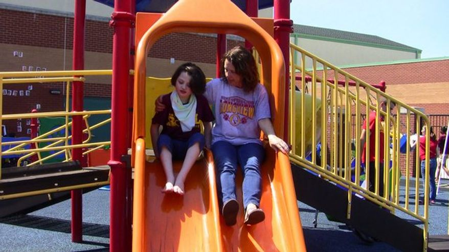 Eva Guimares and teacher Karen Cunningham enjoy a break at Longview, a special-education school in Germantown. Technology will allow disabled students to more fully participate in their education. (Photo courtesy of Longview School)