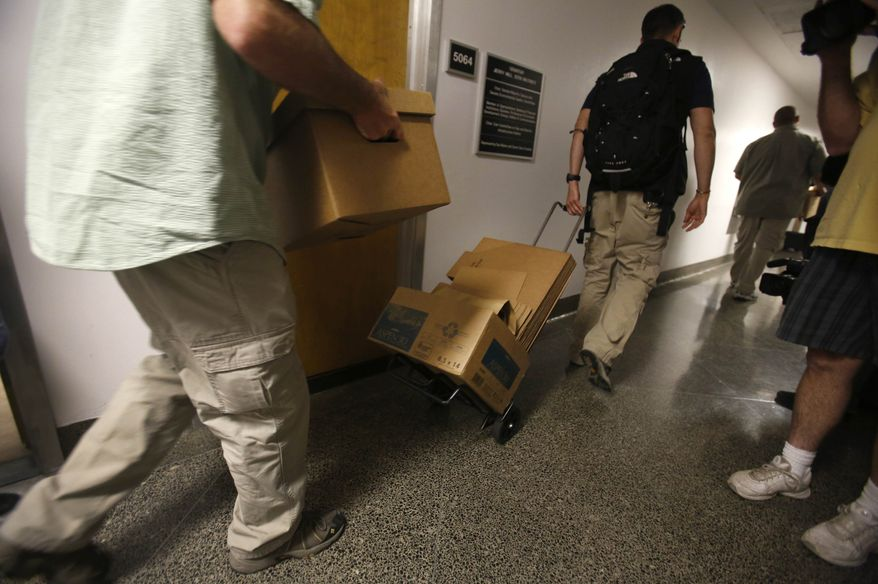 FBI agents leave with boxes of material from the office of State Sen. Ron Calderon, D-Montebello, in Sacramento, Calif., Tuesday, June 4, 2013. Search warrants were served about at Calderon's office and the office of the legislature's Latino caucus, around 3 p.m., but would not disclose the reason for the investigation. Calderon was not present during the search. (AP Photo/Rich Pedroncelli)