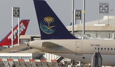 **FILE** A plane of the Saudi Arabian Airlines (foreground) and a plane of Tam Airlines are seen on the tarmac at Roissy Airport in Paris on April 18, 2010. (Associated Press)