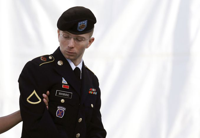 Army Pfc. Bradley Manning is escorted into a courthouse at Fort Meade, Md., on Wednesday, June 5, 2013, on the third day of his court-martial. The soldier is charged with indirectly aiding the enemy by sending troves of classified material to WikiLeaks. He faces up to life in prison. (AP Photo/Patrick Semansky)