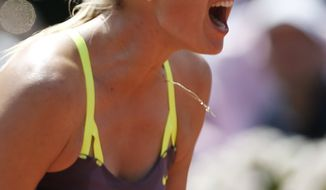 Russia's Maria Sharapova screams after winning the second set in the quarterfinal match against Serbia's Jelena Jankovic at the French Open tennis tournament, at Roland Garros stadium in Paris, Wednesday June 5, 2013. (AP Photo/Petr David Josek)