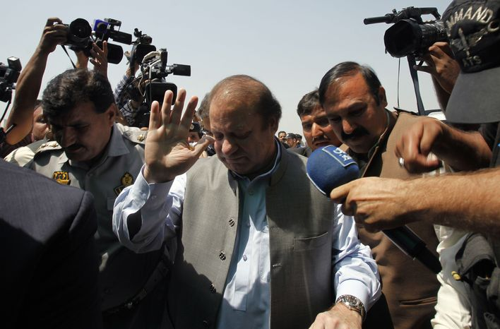 Pakistan's incoming prime minister, Nawaz Sharif, center, surround by media persons, arrives to attend the first National Assembly session in Islamabad, Pakistan, Saturday, June 1, 2013. (AP Photo/Anjum Naveed)