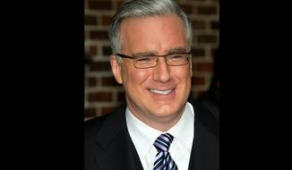 "Turner Sports said Wednesday that it is hiring Keith Olbermann, shown here leaving a taping of the ""Late Show with David Letterman"" in in 2011, to host its postseason baseball studio show. (AP Photo/Charles Sykes, file)"