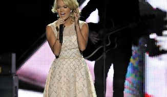 ** FILE ** Carrie Underwood performs at the 2013 CMT Music Awards at the Bridgestone Arena in Nashville, Tenn., on Wednesday, June 5, 2013. (Donn Jones/Invision/AP)