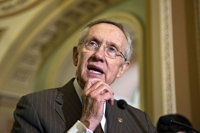**FILE** Senate Majority Leader Harry Reid, Nevada Republican, speaks with reporters on Capitol Hill in Washington on June 4, 2013, following a Democratic strategy session. (Associated Press)