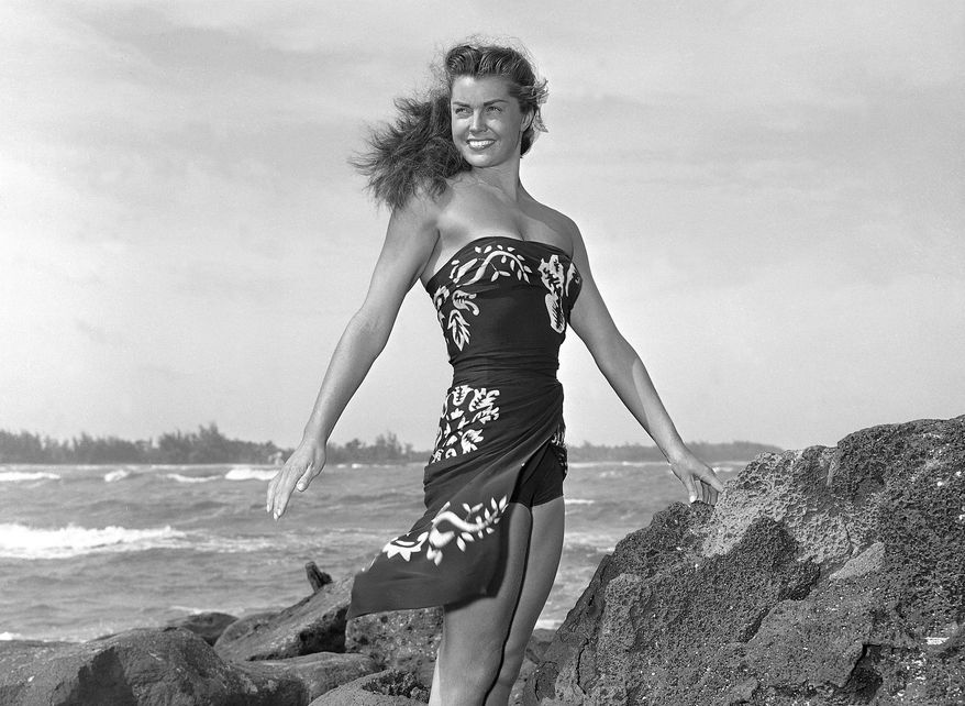 """MGM swimming star Esther Williams poses on location for the film """"Pagan Love Song"""" in May 1950. Miss Williams died in her sleep on Thursday, June 6, 2013, in Beverly Hills, Calif., at age 91, her publicist said. (AP Photo/Metro-Goldwyn-Mayer)"""