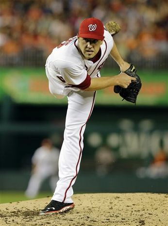 Washington Nationals starting pitcher Nathan Karns throws during an interleague baseball game against the Baltimore Orioles at Nationals Park Tuesday, May 28, 2013, in Washington. (AP Photo/Alex Brandon)