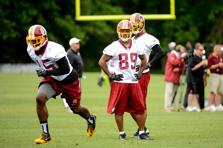 Washington Redskins wide receiver Santana Moss (89), center, watches drills during a NFL football organized team activity at Redskins Park, Ashburn, Va., Thursday, June 6, 2013. (Andrew Harnik/The Washington Times)