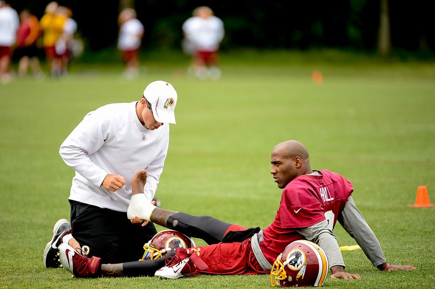 Washington Redskins cornerback DeAngelo Hall (23) gets his foot tapped during a NFL football organized team activity at Redskins Park, Ashburn, Va., Thursday, June 6, 2013. (Andrew Harnik/The Washington Times)