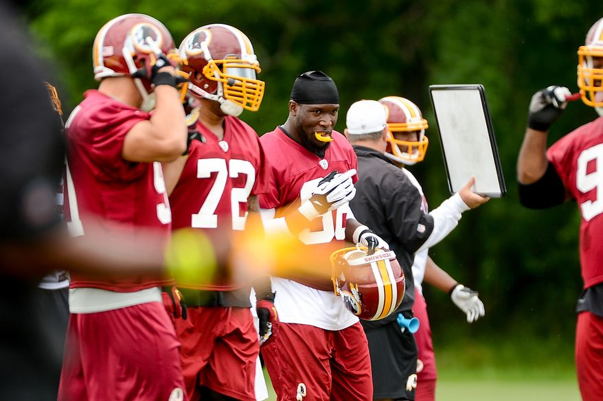 Washington Redskins outside linebacker Brian Orakpo (98), center, during a NFL football organized team activity at Redskins Park, Ashburn, Va., Thursday, June 6, 2013. (Andrew Harnik/The Washington Times)