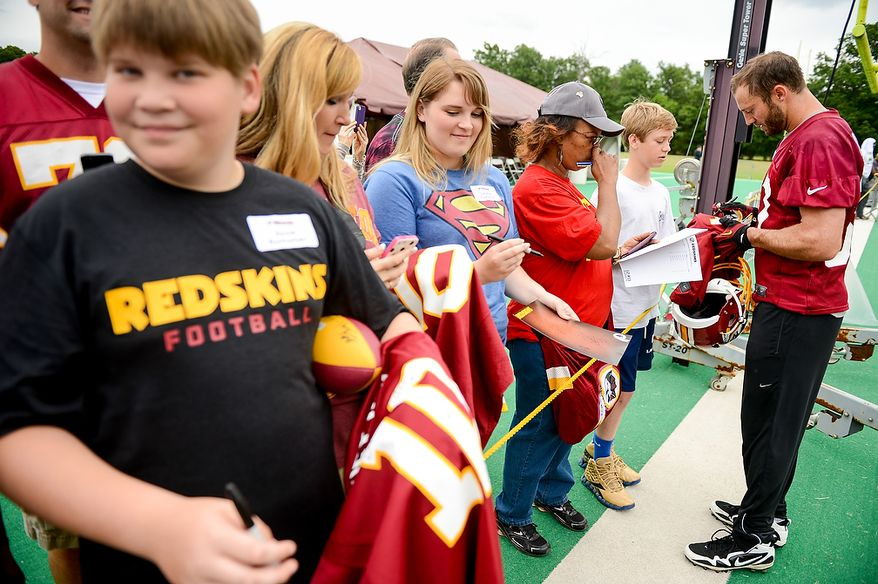 Washington Redskins strong safety Reed Doughty (37) signs autographs following a NFL football organized team activity at Redskins Park, Ashburn, Va., Thursday, June 6, 2013. (Andrew Harnik/The Washington Times)