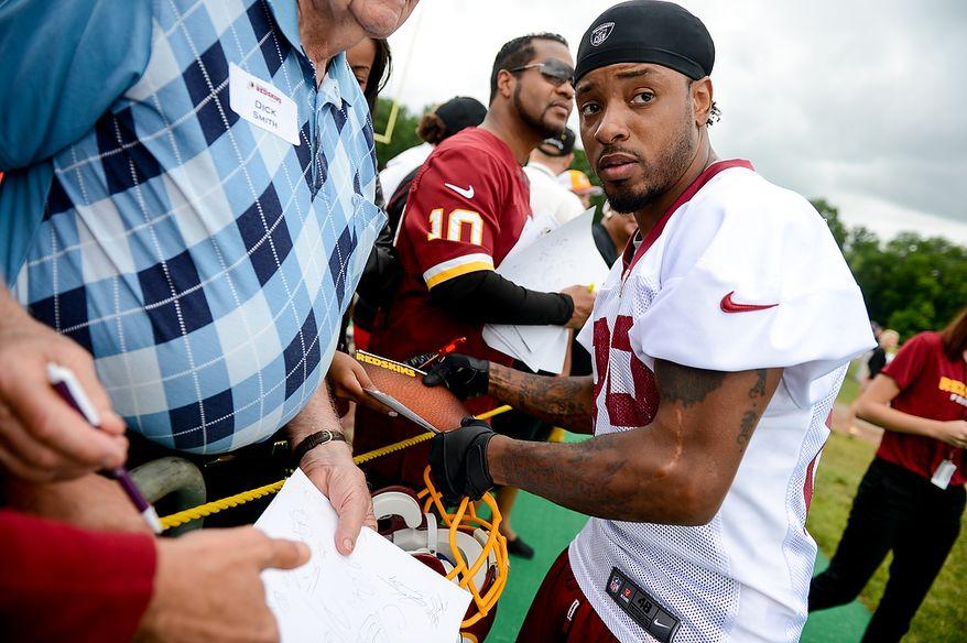 Washington Redskins wide receiver Santana Moss (89) signs autographs following a NFL football organized team activity at Redskins Park, Ashburn, Va., Thursday, June 6, 2013. (Andrew Harnik/The Washington Times)