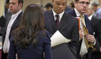 Job seekers wait to speak with Patrice Tosi (second from left) of BluePay during a career fair in Rolling Meadows, Ill., on Wednesday, May 29, 2013. (AP Photo/M. Spencer Green)