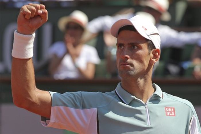 Serbia's Novak Djokovic clenches his fist after scoring against Spain's Rafael Nadal in their semifinal match at the French Open tennis tournament, at Roland Garros stadium in Paris, Friday June 7, 2013. (AP Photo/Michel Euler)