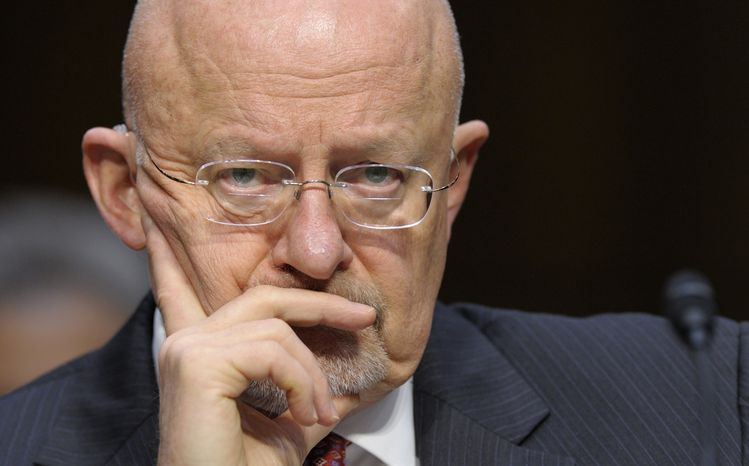 **FILE** James Clapper, Director of National Intelligence, listens March 12, 2013, to testimony at the Senate Intelligence Committee hearing on Capitol Hill in Washington, where he testified about worldwide threats. (Associated Press)