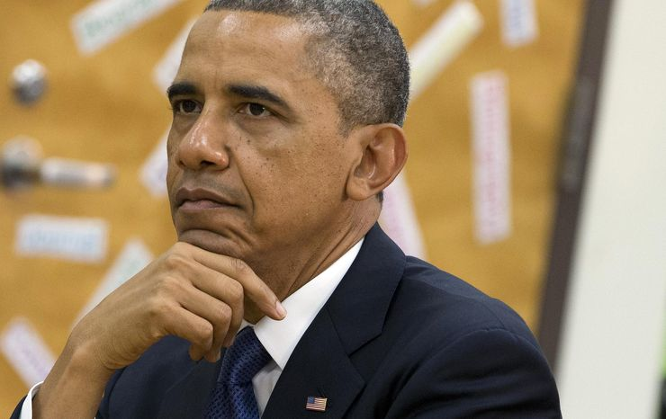 """** FILE ** President Barack Obama views a math project during a tour of Mooresville Middle School in Mooresville, N.C., Thursday, June 6, 2013. The president traveled to Mooresville, N.C., to promote his """"Middle Class Jobs and Opportunity Tour."""" (AP Photo/Evan Vucci)"""