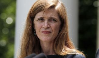 ** FILE ** Samantha Power, President Barack Obama's nominee to be the next U.N. Ambassador, listens to Obama speak in the Rose Garden at the White House in Washington, Wednesday, June 5, 2013, where he made the announcement. (AP Photo/Charles Dharapak)