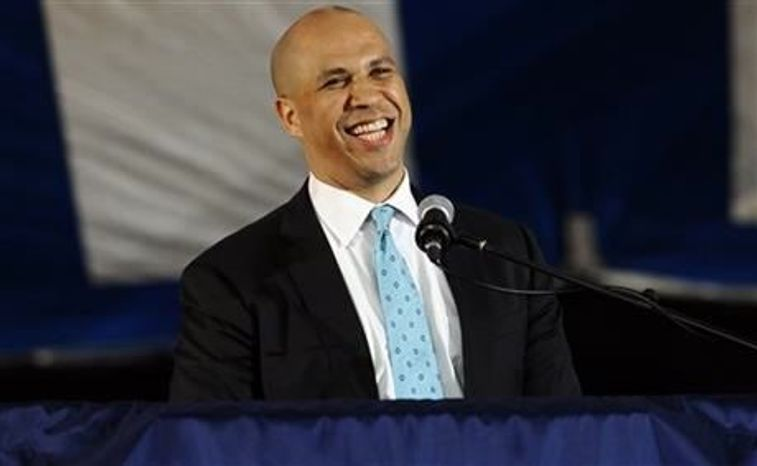 **FILE** Newark Mayor Cory Booker delivers the main address during Class Day for Yale seniors at Yale University in New Haven, Conn., on May 19, 2013. (Associated Press)