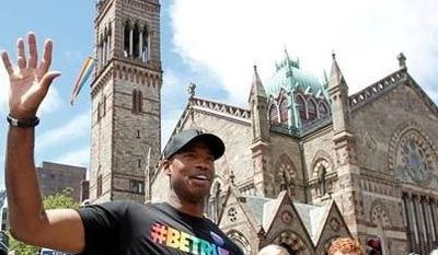 NBA veteran Jason Collins, left, marches in Boston's gay pride parade alongside U.S. Rep. Joe Kennedy III, a college roommate, second right, and Kennedy's wife Lauren Anne Birchfield, center, Saturday, June 8, 2013, in Boston. (Associated Press)