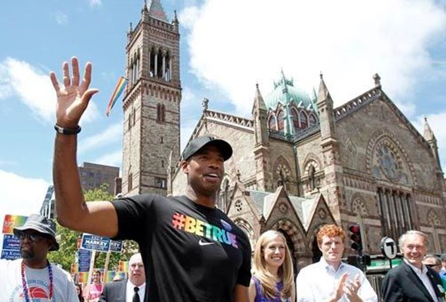 NBA veteran Jason Collins, left, marches in Boston's gay pride parade alongside U.S. Rep. Joe Kennedy III, a college roommate, second right, and Kennedy's wife Lauren Anne Birchfield, center, Saturday, June 8, 2013, in Boston. (Associated Press)