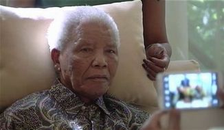** FILE **  The ailing anti-apartheid icon Nelson Madela is filmed on Monday, April 29, 2013, more than three weeks after being released from hospital. (Associated Press)