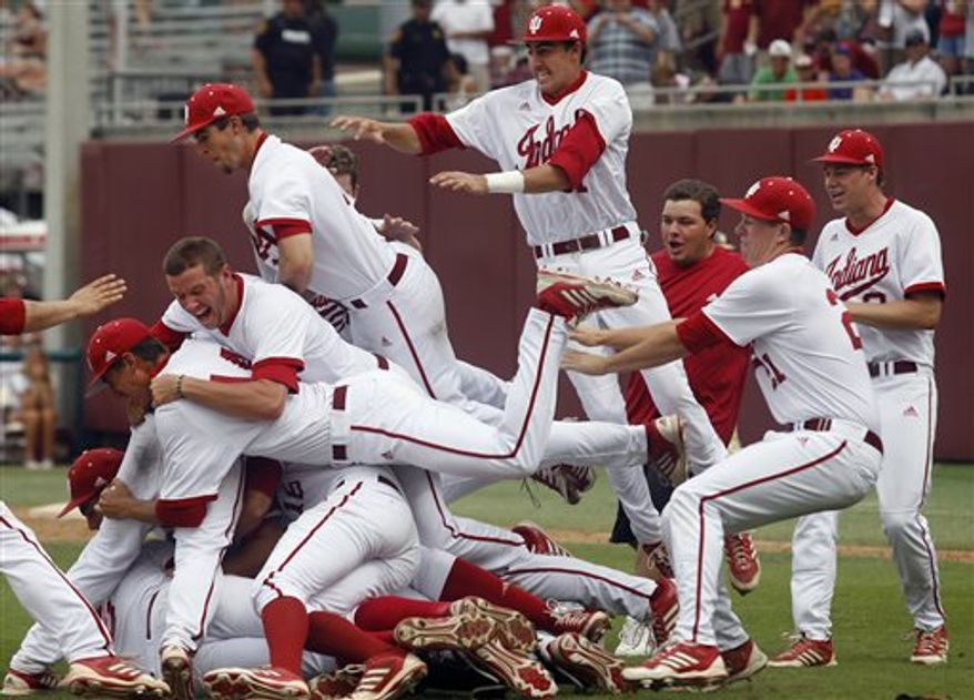 Indiana players pile on top of each other at the conclusion of an NCAA college baseball tournament super regional game against Florida State on Sunday, June 9, 2013, in Tallahassee, Fla. Indiana won 11-6, and advances to the College World Series. (AP Photo/Phil Sears)