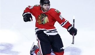 Chicago Blackhawks right wing Patrick Kane celebrates his goal against the Los Angeles Kings during the second overtime period in Game 5 of the NHL hockey Stanley Cup playoffs Western Conference finals, Saturday, June 8, 2013 in Chicago. (AP Photo/Charles Rex Arbogast)