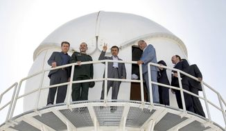 Iranian President Mahmoud Ahmadinejad (third from left) flashes a victory sign during the inauguration of a space tracking center near Delijan, Iran, 125 miles south of Tehran, on Sunday, June 9, 2013. (AP Photo/Fars News Agency, Mahdi Marizad)
