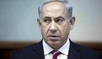 Israeli Prime Minister Benjamin Netanyahu attends the weekly Cabinet meeting in his office in Jerusalem on Sunday, June 9, 2013. (AP Photo/Abir Sultan, Pool)