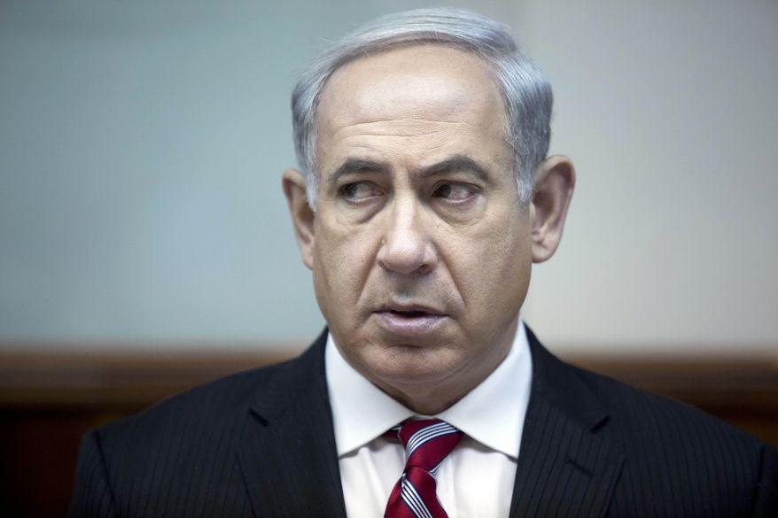 Israeli Prime Minister Benjamin Netanyahu attends the weekly Cabinet meeting in his office in Jerusalem on Sunday, June 9, 2013. (AP Photo/Abir Sultan, Pool)