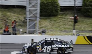Jimmie Johnson crosses the finish line to win the NASCAR Pocono 400 auto race on Sunday, June 9, 2013, in Long Pond, Pa. (AP Photo/Matt Slocum)