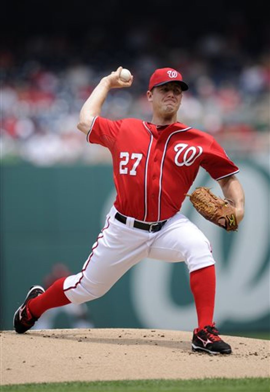 Washington Nationals starting pitcher Jordan Zimmermann delivers against the Minnesota Twins during the first inning of the first baseball game of a day-night interleague doubleheader on Sunday, June 9, 2013, in Washington. (AP Photo/Nick Wass)