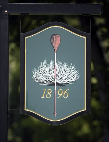 In this Aug. 3, 2005, file photo, a sign in front of Merion Golf Club in Ardmore, Pa., shows the course's symbol, a wicker basket which is used instead of flags to mark the hole on the greens. The venerable course once thought to be too short and small to stage the USGA's marquee event will host the U.S. Open golf championship next week. (AP Photo/H. Rumpf Jr., File)