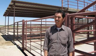 **FILE** Valley Meat Co. owner Rick De Los Santos stands April 15, 2013, in a corral area outside the former cattle slaughterhouse he has converted to a horse slaughter facility in Roswell, N.M. The plant — which has been waiting more than a year for federal approval of its operations — has become ground zero for an emotional, national debate over a return to domestic horse slaughter. (Associated Press)
