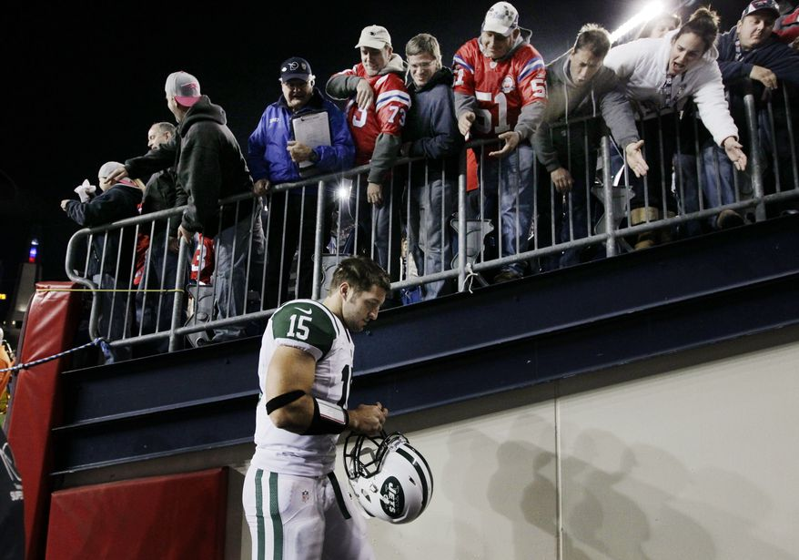 **FILE** New York Jets quarterback Tim Tebow (15) leaves the field after their 29-26 loss in overtime to the New England Patriots in an NFL football game in Foxborough, Mass. Sunday, Oct. 21, 2012. (AP Photo/Elise Amendola)