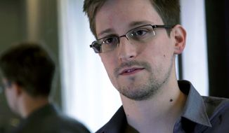 ** FILE ** This Sunday, June 9, 2013, file photo provided by The Guardian Newspaper in London shows Edward Snowden, in Hong Kong. Snowden has left Moscow's Sheremetyevo airport and entered Russia his lawyer said on Thursday Aug. 1, 2013. (AP Photo/The Guardian, Glenn Greenwald and Laura Poitras, File)