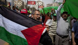 Egyptian protesters chant slogans against Israel, holding Palestinian flags as they march for marking Jerusalem Day in Cairo on June 7, 2013. (Associated Press)