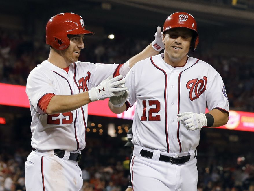 Tyler Moore celebrates hitting a two-run home run against the Baltimore Orioles with first baseman Adam LaRoche. (Associated Press photo)