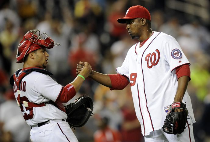 Nationals closer Rafael Soriano, right, and catcher Jhonatan Solano, left, celebrate the Nationals 5-4 win over the Minnesota Twins on Sunday and a doubleheader sweep. (Associated Press photo).