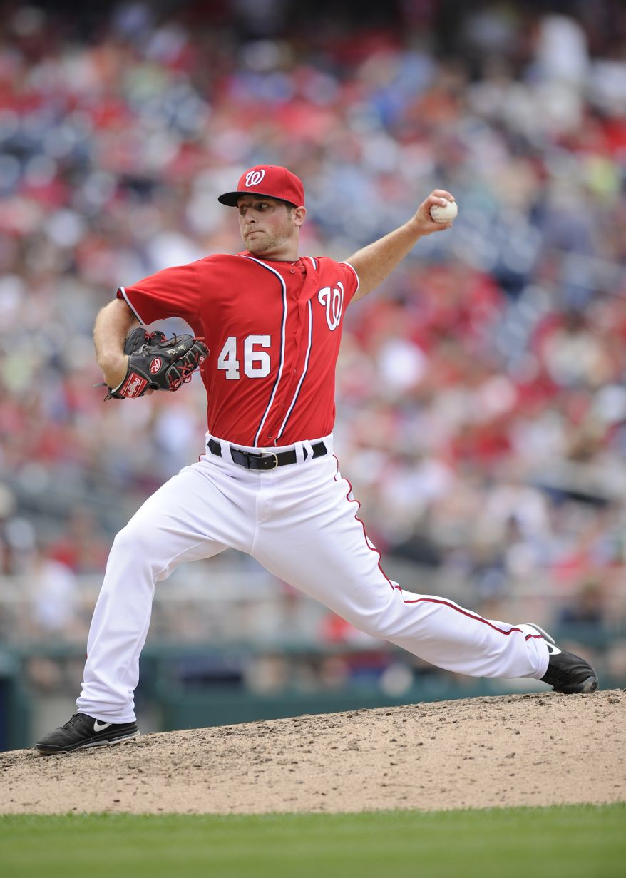 Washington Nationals relief pitcher Ian Krol (46) delivers a pitch against the Minnesota Twins during the eighth inning of the first baseball game of a day-night interleague doubleheader, Sunday, June 9, 2013, in Washington. The Nationals won 7-0. (AP Photo/Nick Wass)