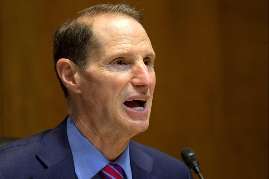 Sen. Ron Wyden, Oregon Democrat faulted National Intelligence Director James R. Clapper for failing to give him a straight answer when he was asked about potential snooping on Americans during an oversight hearing in March. (Associated Press)